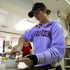 "Danvers: Becca Kemmer, scoops ice cream on top of a waffle at Cherry Farm Creamery in Danvers, during their annual ""Ice Cream for Breakfast"" fundraiser on Saturday morning. David Le/Salem News"