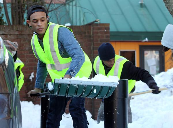 Salem: Eduardo Rodriguez, 17, shovels snow in the parking lot adjacent to Artist's Row in downtown Salem. David Le/Salem News
