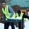 Salem: Eduardo Rodriguez, 17, shovels snow in the parking lot adjacent to Artist's Row in downtown Salem. David Le/Salem News