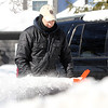 Danvers: Jon Sherman, of Danvers, uses a snowblower to clear his driveway on Sunday afternoon. David Le/Salem News