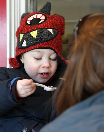 """Danvers: Nathaniel Martinez, 3, of Peabody, takes a bite out of his ice cream at Cherry Farm Creamery in Danvers, during their annual """"Ice Cream for Breakfast"""" fundraiser on Saturday morning. David Le/Salem News"""