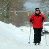 Marblehead: Cindy Anderson, of Yoruba Linda, CA, takes some time to ski down Lafayette St on Saturday afternoon while visiting friends in Marblehead. David Le/Salem News