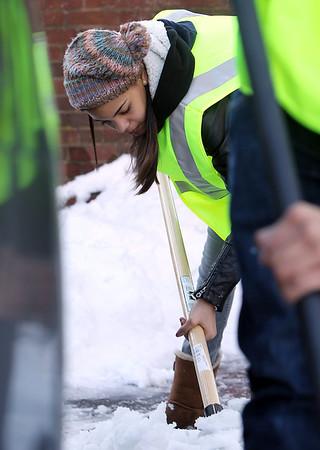 Salem: Elisabeth Batista, 16, of Salem, helps clear snow out in a parking lot adjacent to Artist's Row in downtown Salem on Wednesday afternoon. David Le/Salem News