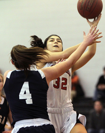 Marblehead: Marblehead sophomore guard Elina Fisher takes a hook shot over AMSA senior Sarah Seymour during the Brad Sheridan Tournament on Tuesday afternoon. David Le/Salem News