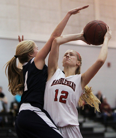Marblehead: Marblehead junior Sara Snadecki takes a contested jump shot while being blanketed by AMSA junior Izzy Russell. David Le/Salem News