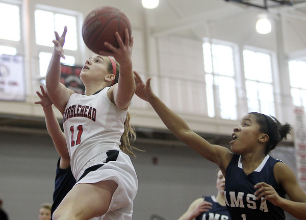 Marblehead: Marblehead sophomore guard Mia Bongiorno glides in for a layup against AMSA during the Brad Sheridan Tournament on Tuesday afternoon. David Le/Salem News