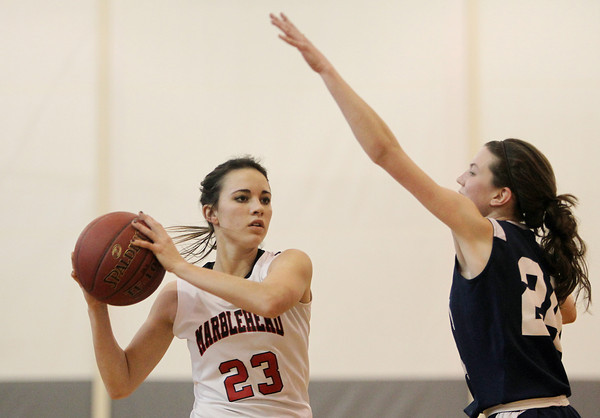 Marblehead: Marblehead junior guard Caroline Helmes looks to pass around AMSA junior Jackie Rochleau, on Tuesday afternoon. David Le/Salem News