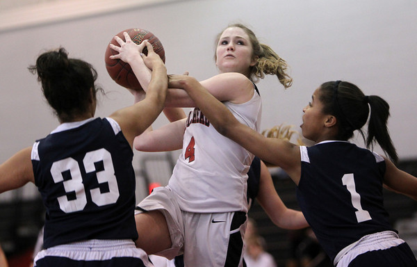 Marblehead: Marblehead junior Emily Freedland gets off a jump shot while being fouled by AMSA's Pranjali Ichalkaranje, left, and Arin Smalls, right, on Tuesday afternoon during the Brad Sheridan Tournament at Marblehead High School. David Le/Salem News