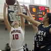Marblehead: Marblehead senior forward Maggie Forbes gets off a jumper ahead of a block attempt from AMSA junior Pranjali Ichalkaranje, on Tuesday afternoon. David Le/Salem News