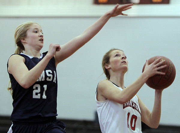 Marblehead: Marblehead senior forward Maggie Forbes, right, goes up for a shot while being covered by AMSA junior Izzy Russell during the Brad Sheridan Tournament on Tuesday afternoon. David Le/Salem News