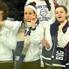 Salem: Swampscott seniors Sasha Matusevich, left, and Emma Walsh, dance along to a song during the second intermission at the Marblehead-Swampscott hockey game on Wednesday evening. David Le/Salem News