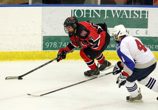 Salem: Marblehead senior winger Aaron DeAngelo, left, carries the puck while being chased by Swampscott senior defenseman Chris Dandreo, during the second period of play on Wednesday evening. David Le/Salem News