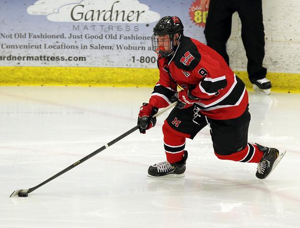 Salem: Marblehead junior defenseman Liam Gillis wheels around the net on the power play against Swampscott. David Le/Salem News