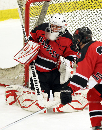 Salem: Marblehead junior goalie Harrison Young makes a save against Swampscott in the second period of play on Wednesday evening. David Le/Salem News