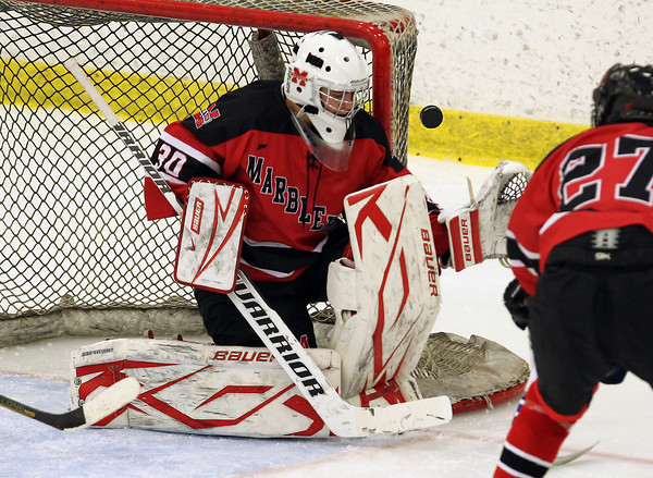 Salem: Marblehead junior goalie Harrison Young makes a save on a shot from a Swampscott forward and deflects it away behind the net. David Le/Salem News