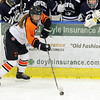 Salem: Beverly High School freshman forward Anna O'Neill plays the puck along the boards in front of the Medford bench on Saturday afternoon. David Le/Salem News