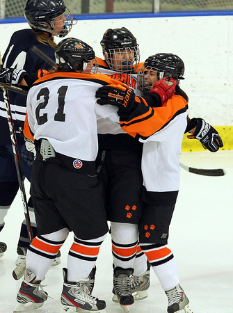 Salem: Beverly sophomore Karen Hovey, center, celebrates her third period goal with teammates sophomore Isabelle Straw, left, and senior Katie Szela, right. David Le/Salem News