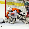 Salem: Beverly senior goalie Ami Thompson keeps her eyes right on the puck as it crosses through her crease against Medford on Saturday afternoon. David Le/Salem News