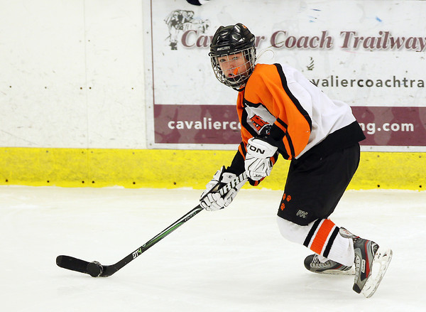 Salem: Beverly High School junior forward Nicole Woods controls the puck against Medford and looks to pass to an open teammate during the third period of play. David Le/Salem News
