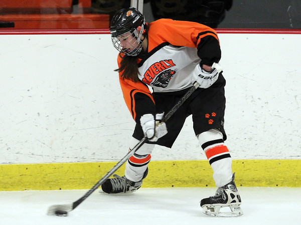 Woburn: Beverly junior forward Nicole Kamens controls the puck along the boards against Arlington Catholic on Wednesday evening. David Le/Salem News