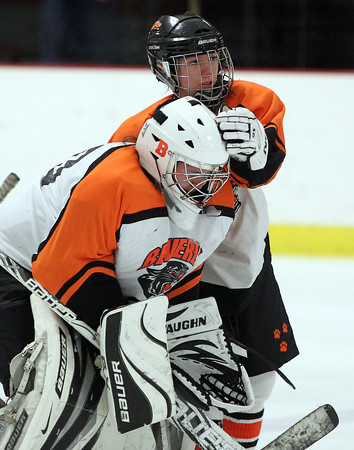 Woburn: Beverly junior Nicole Woods consoles senior goalie Ami Thompson with a pat on the head after the Panthers fell to Arlington Catholic 4-0 on Wednesday evening. David Le/Salem News