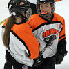Woburn: Beverly senior Livvy Konaxis, right, talks with freshman Anna O'Neill, left, prior to the start of the third period of play on Wednesday evening against Arlington Catholic. David Le/Salem News