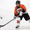 Woburn: Beverly junior forward Nicole Woods carries the puck up-ice against Arlington Catholic on Wednesday evening. David Le/Salem News