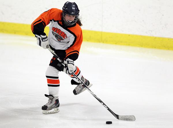 Woburn: Beverly freshman defenseman Anna Hayden slides a pass across ice to a teammate against Arlington Catholic on Wednesday evening. David Le/Salem News