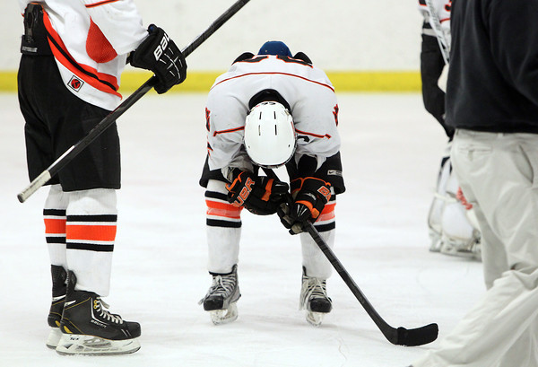 Woburn: Beverly junior captain Connor Irving keels over after the Panthers fell on a last second goal to NEC rival Danvers on Friday evening. David Le/Salem News
