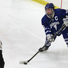 Woburn: Danvers senior captain Joe Strangie controls the puck against Beverly on Friday evening. David Le/Salem News