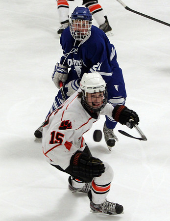 Woburn: Danvers junior Ryan Cassidy and Beverly sophomore Jesse McLaughlin keep their eyes on the puck as it soars high in the air. David Le/Salem News