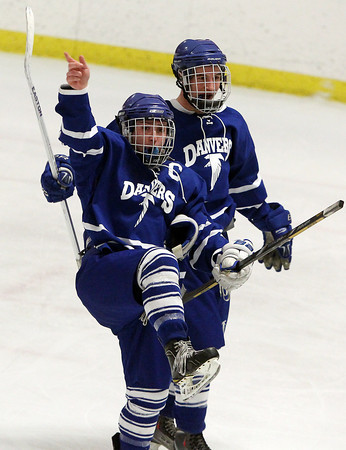 Woburn: Danvers senior captain kicks his leg high and waves his finger in the air after classmate and fellow captain AJ Couto scored the go-ahead goal with 11 seconds to play in the third period. David Le/Salem News