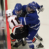 Woburn: Danvers sophomore Stephen Ganley and junior Kevin Hodgkins combine to check Beverly's Ryan Santo and separate him from the puck along the boards on Friday evening. David Le/Salem News