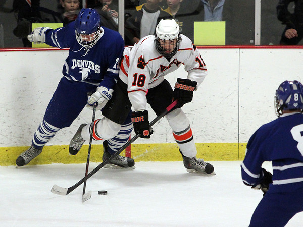 Woburn: Beverly senior forward Nate McLaughlin, right, and Danvers sophomore Stephen Ganley fight for control of the puck on Friday evening. David Le/Salem News