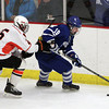 Woburn: Danvers senior captain Rob Buchanan carries the puck while being pursued by Beverly junior defenseman Sean Munzing on Friday evening. David Le/Salem News
