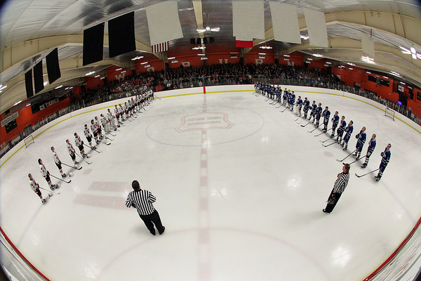 Woburn: The Beverly and Danvers boy's hockey teams line up at the blue lines for the playing of the National Anthem prior to the start of their D2 North quarterfinal matchup at O'Brien Rink in Woburn. The Falcons managed to edge their NEC rivals 4-3 on a last second goal by Danvers senior captain AJ Couto, completing his hat tick and sending the top ranked Panthers home. David Le/Salem News