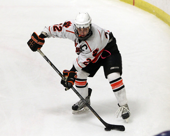 Woburn: Beverly junior captain Connor Irving control the puck along the boards on a Panther power play on Friday evening. David Le/Salem News