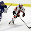 Woburn: Beverly junior captain Connor Irving carries the puck up-ice against Danvers on Friday evening. David Le/Salem News