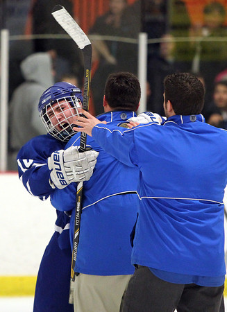 Woburn: Danvers High School senior captain Joe Strangie screams in celebration as he gets a hug from assistant coach Steve Baldassare. Strangie and the No. 8 Falcons upset the top ranked Beverly Panthers in the D2 North quarterfinals on Friday evening. David Le/Salem News