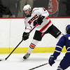 Woburn: Beverly senior forward Nate McLaughlin fires a pass up the boards against Danvers on Friday evening. Tied 3-3 with only 11 seconds to play in the third period, Danvers senior AJ Couto sent the Panthers home by completing his hat trick and scoring the game winning goal. David Le/Salem News