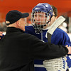 Woburn: Danvers senior captain Joe Strangie talks with Beverly Head Coach Bob Gilligan after the game on Friday evening. Stangie and the Falcons sent the Panthers home with a 4-3 victory at O'Brien Rink in Woburn. David Le/Salem News