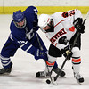 Woburn: Danvers senior winger Adam Merry, left, and Beverly junior forward Graham Doherty get tangled up as they battle for control of the puck. David Le/Salem News