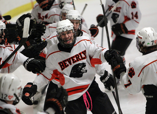 Woburn: Beverly senior forward Nate McLaughlin gets high fives from his teammates after scoring a goal against Danvers on Friday evening. David Le/Salem News
