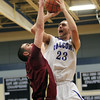 Byfield: Danvers senior captain Nick McKenna drains a contested jump shot over Whittier Tech senior Nathan Frongillo during the second quarter of play. David Le/Salem News