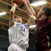 Byfield: Danvers senior captain Dan Connors hits a fadeaway jumper over Whittier Tech senior Nathan Frongillo, during the second quarter of play in the D3 North Semi-Final on Tuesday evening. David Le/Salem News