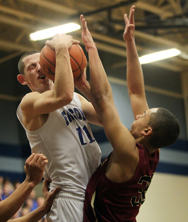 Byfield: Danvers senior captain Eric Martin gets fouled by Whittier Tech's Jaylin Deveau, right, as he drives hard to the hoop in the second quarter of play. Martin and the Falcons easily dispatched of the Wildcats 69-51 on Tuesday evening at Triton Regional High School. David Le/Salem News