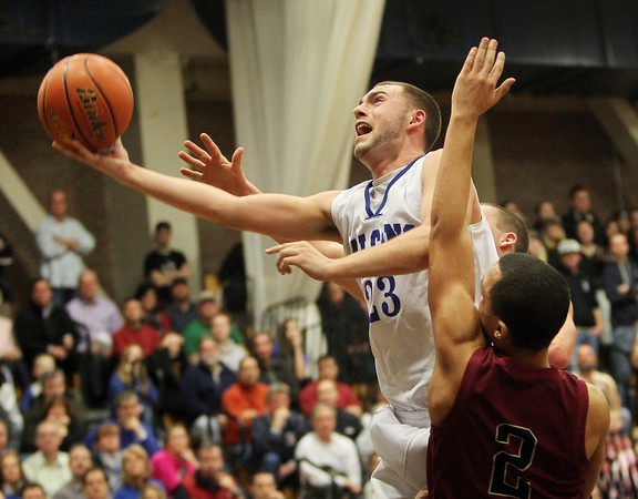 Byfield: Danvers High School senior captain Nick McKenna splits two Whittier defenders and converts a layup while getting fouled in the process. McKenna scored 17 points for the Falcons as Danvers advances to its second D3 North Final in as many years. David Le/Salem News