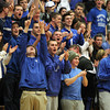 Byfield: The Danvers High School fan section explodes in excitement after a three-pointer from senior Nick Bates in the first half of play against Whittier Tech on Tuesday evening. David Le/Salem News