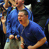 Byfield: Danvers seniors Connor Morrison, left, and Alex Grant, right, scream in excitement after a big bucket by senior captain Nick McKenna. McKenna and the Falcons convincingly defeated the Whittier Wildcats 69-51 at Triton Regional High School to advance to the D3 North Finals for the second time in as many years. David Le/Salem News
