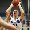 Byfield: Danvers senior forward Nick Bates lines up a three-point shot against Whittier Tech on Tuesday evening. Bates was the top scorer for the Falcons, pouring in 19 points and helping the defending D3 State Champions get back to the D3 North Final with a 69-51 win over the Wildcats. David Le/Salem News